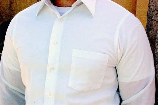 An example of white undershirt showing through light colored shirts.
