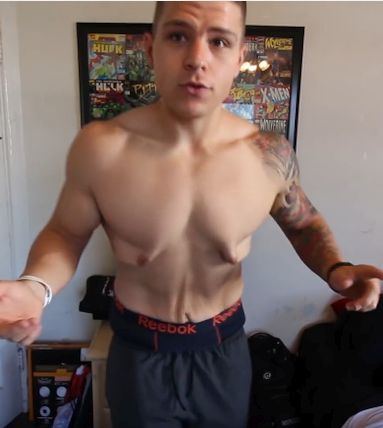 A man showing his excess skin before wearing compression shirts.