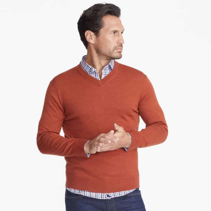 Wear button-up collared shirt under v-neck sweater