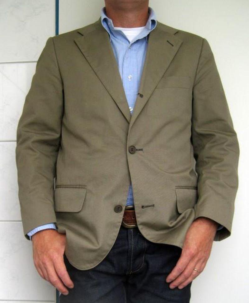 visible white crew neck undershirt under open collar shirt