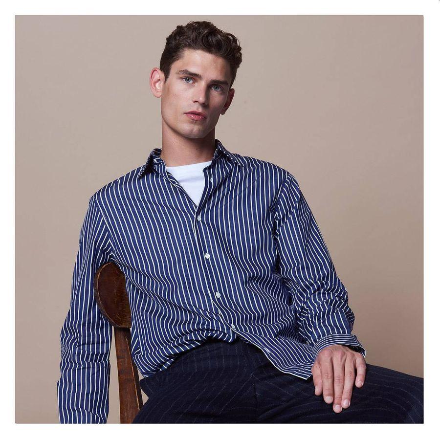 wearing white crew neck undershirt under open collar shirt