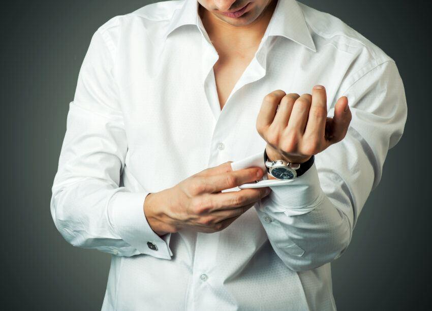 Wear deep v-neck tan undershirt under white dress shirt with open collar